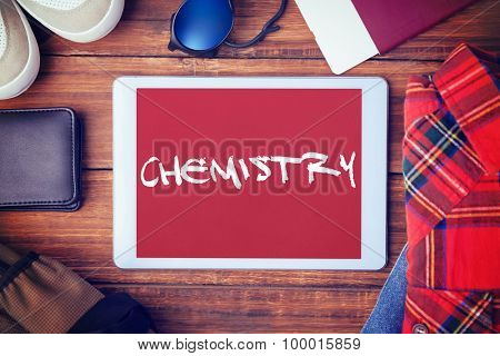 The word chemistry and differents objects using every days against red background