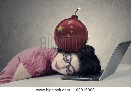 Businesswoman With Chinese Flag On The Bomb