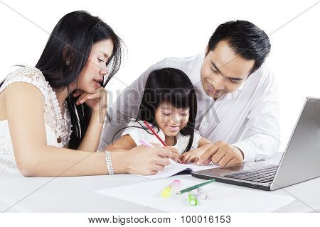 Child Learns To Write With Parents