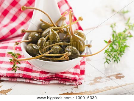 Capers In A Spoon With Herbs.