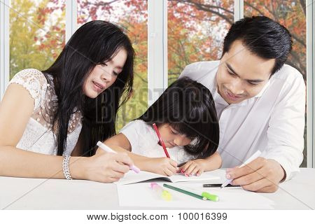 Clever Kid Learning With Dad And Mom