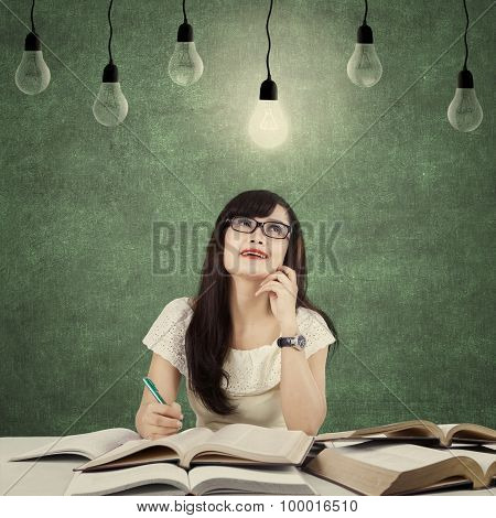 Clever Student Get Inspiration Under Light Bulb