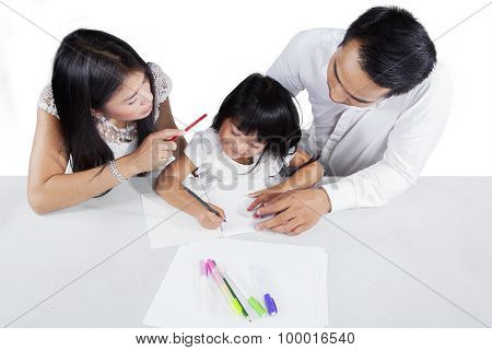Closeup Of Two Parents Teach Their Kid To Learn