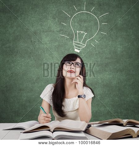 Creative Learner Studying And Thinks Idea In Class