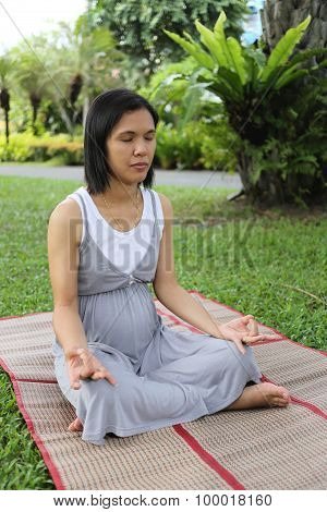 Thai Pregnant Mom Was Meditation In The Garden.