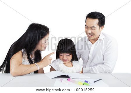 Hispanic Mother Scolding Her Child For Studying