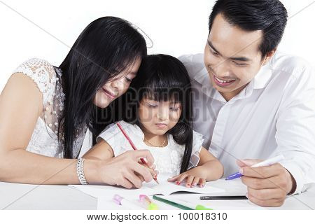 Hispanic Parents Teach Their Child To Write