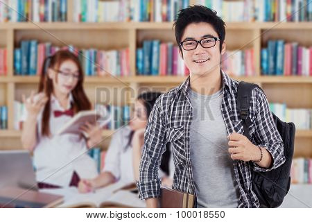 Male College Student With His Team In Library