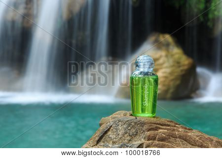 Spa Shampoo on Waterfall Background, freshness concept.