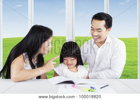 Mother Scolding Her Child For Doing Homework