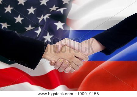 People Handshake With The Russian And American Flags