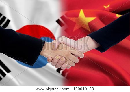 Politicians Handshake With Chinese And South Korean Flags