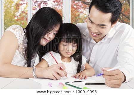 Two Asian Parents Teach Their Child To Write