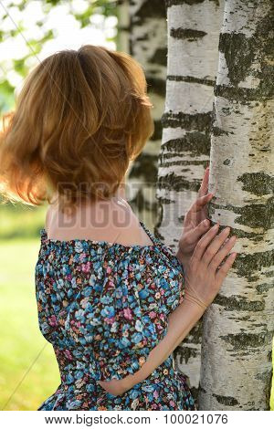 woman in a dress with open shoulders is about Birch