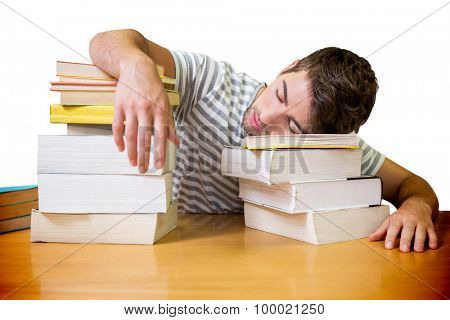 Student asleep in the library against white background with vignette