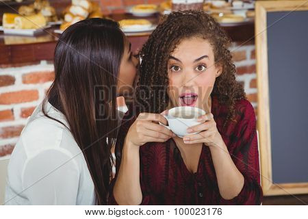 Beautiful woman shocked by a secret in a cafe