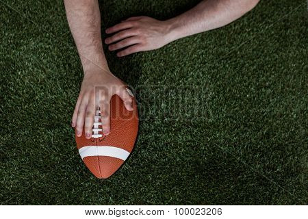 Close up view of an american football player scoring a touchdown