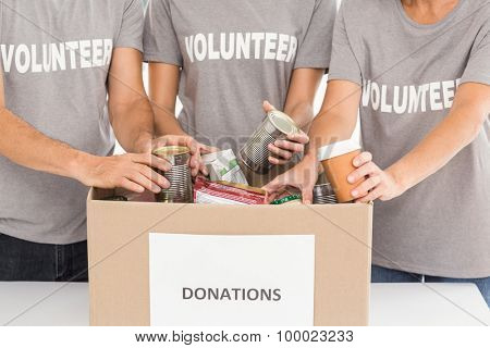 Volunteers sorting donations in the office