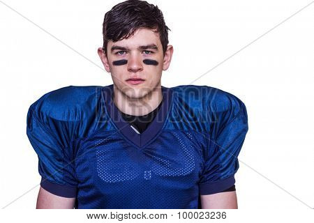 Portrait of a stern american football player on white background