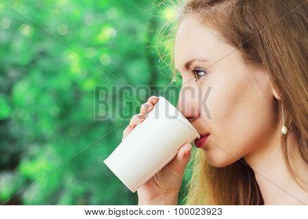 Beautiful Young Woman  Drinking Takeaway Coffee