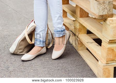 Woman's Legs In Jeans And Flat Shoes