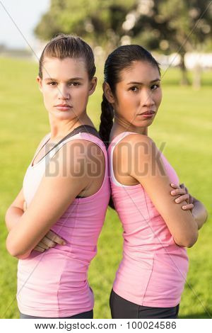 Portrait of two women wearing pink for breast cancer in parkland