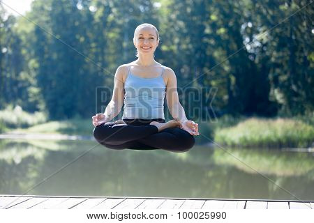 Yogi Female Meditating In Thin Air
