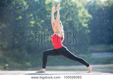 Teenage Girl In Warrior 1 Pose
