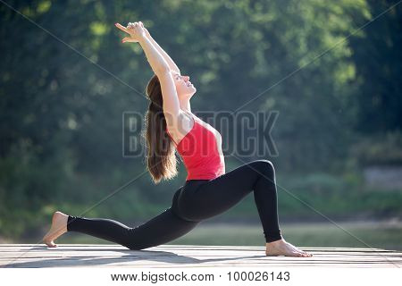 Teenage Girl Doing Crescent Lunge Pose
