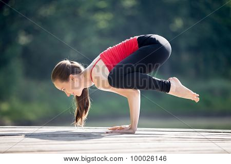 Teenage Girl Doing Bakasana Pose