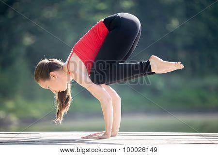 Teenage Girl Doing Crane Pose