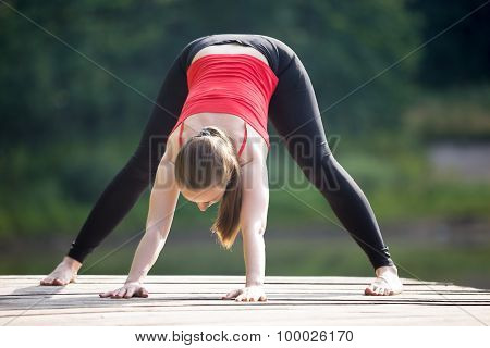 Teenage Girl Doing Wide Legged Forward Bend