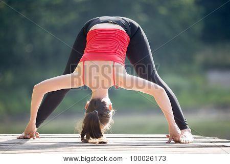 Teenage Girl Doing Standing Straddle Forward Bend