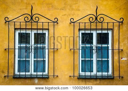 Two Windows With Ornamental Metal Lattice
