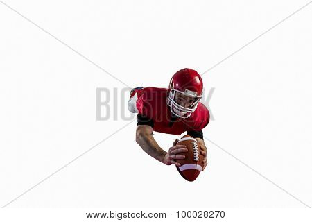 American football player catching football on american football field