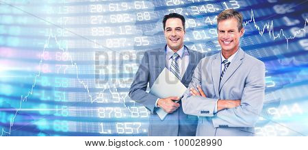 Business team standing arms crossed and with a folder against stocks and shares Business team standing arms crossed and with a folder against a white screen