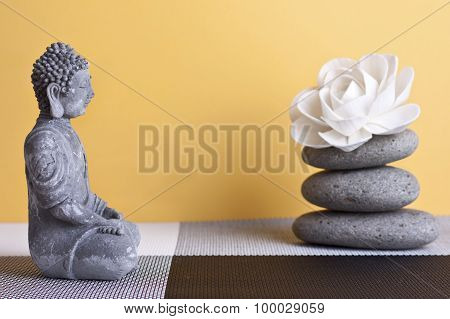 Stone Sitting Buddha And Frankincense