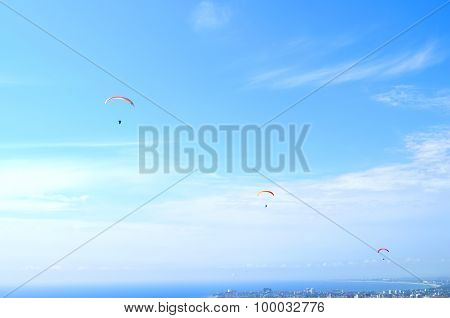 Paraglider In The Blue Sky