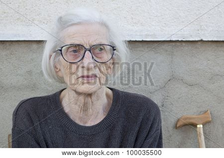 Portrait Of A Ninety Years Old Grandma With Walking Stick Outdoors