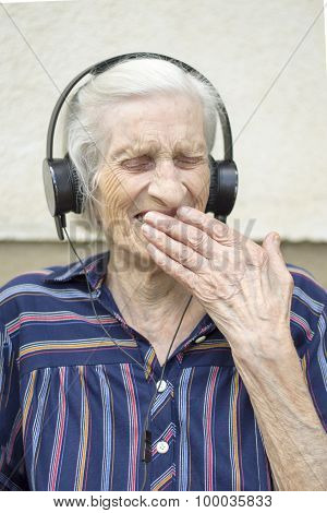 Ninety Years Old Woman Reaction To Modern Music. Grandma Listening To Music On Headphones
