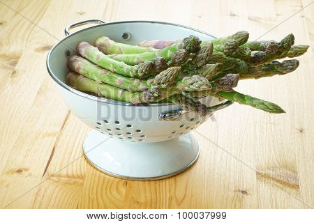 Asparagus In A White Enamel Colander