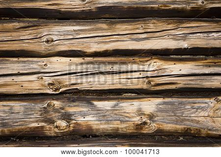 Background from old wooden wall of logs  with knots