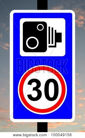 Speed camera enforcing 30mph speed limit traffic sign