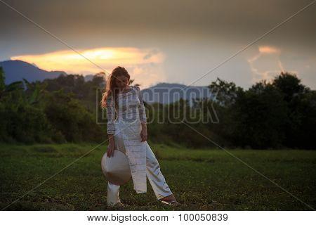 Blonde Girl In Vietnamese Dress Looks Down On Field