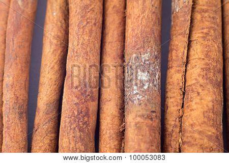 Photo of cinnamon sticks, textured
