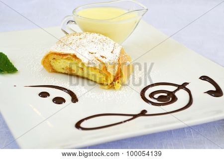 Apple strudel with vanilla cream and mint