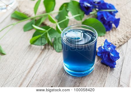 Fresh Butterfly Pea Juice And Butterfly Pea Flower On Wooden Table