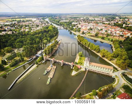 Hydroelectric plant on Elbe (Labe) River in Nymburk. Aerial view to industrial landscape with river in Czech Republic, Central Europe.
