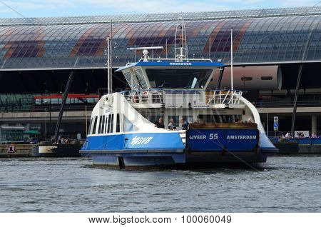 Dutch passenger ferry heading for dock Central Station Amsterdam