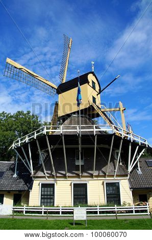 Picturesque Dutch windmill along the canal near Weesp
